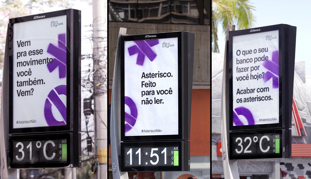 Mensagens do movimento AsteriscoNão em anúncios de relógio nas ruas de São Paulo.