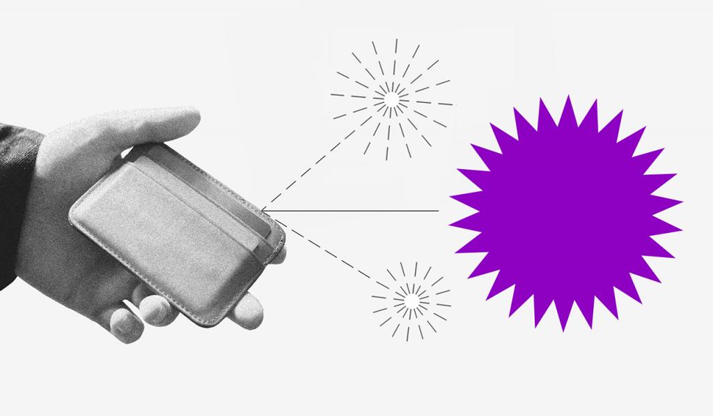 Comprar online com segurança: Mão segurando carteira com pequenos fogos de artificio saindo