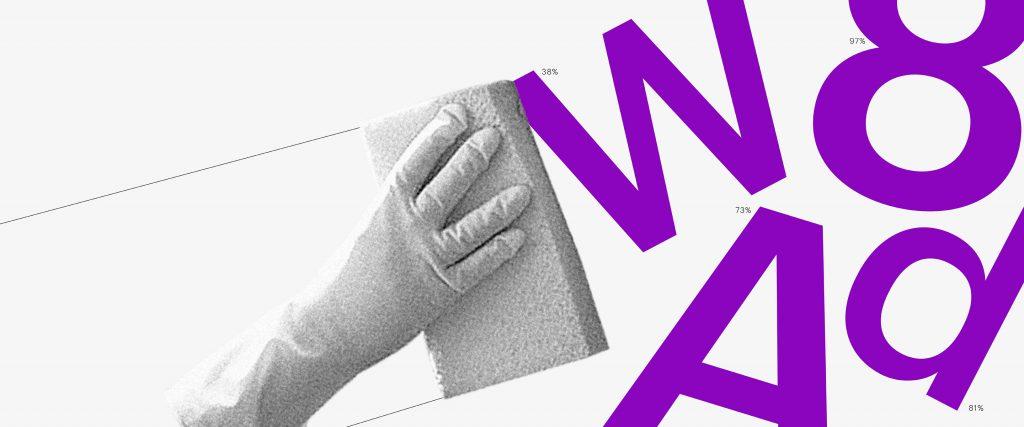Imagem de uma mão com luva usando uma esponja para apagar os caracteres W, 8, A e d.
