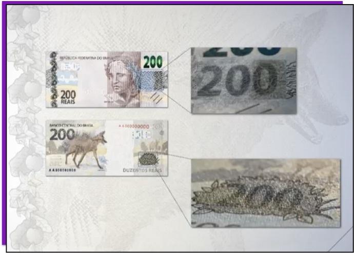 Detalhe da nota de 200 reais que mostra o número 200 escondido