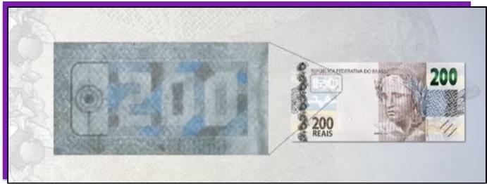 Detalhe da nota de 200 reais que mostra o número 200 dentro de um quebra-cabeça