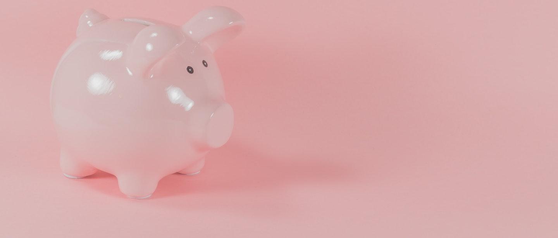cofrinho de porquinho rosa com fundo rosa